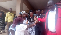 Nana Akua Bemah being consoled after the death of her son