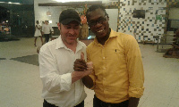 Head coach of Bechem United, Manuel Zachariah  with an official of the club