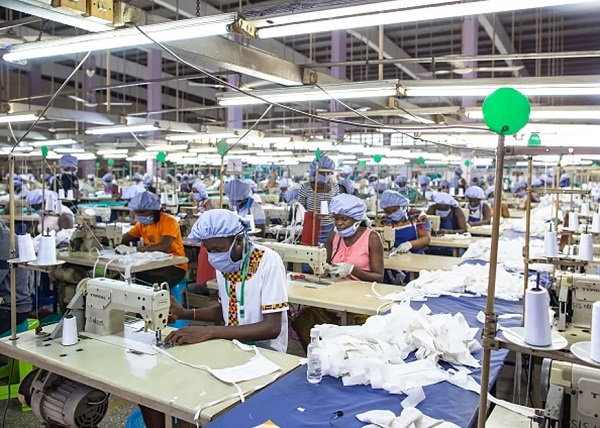 Workers assemble personal protective equipment for frontline health staff at a factory in Accra comm