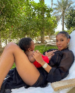 Mot5her enjoying fresh air with her baby