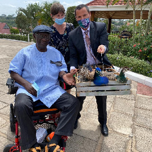 Gregory Andrews with former president, John Kufuor, and the peacock gifts