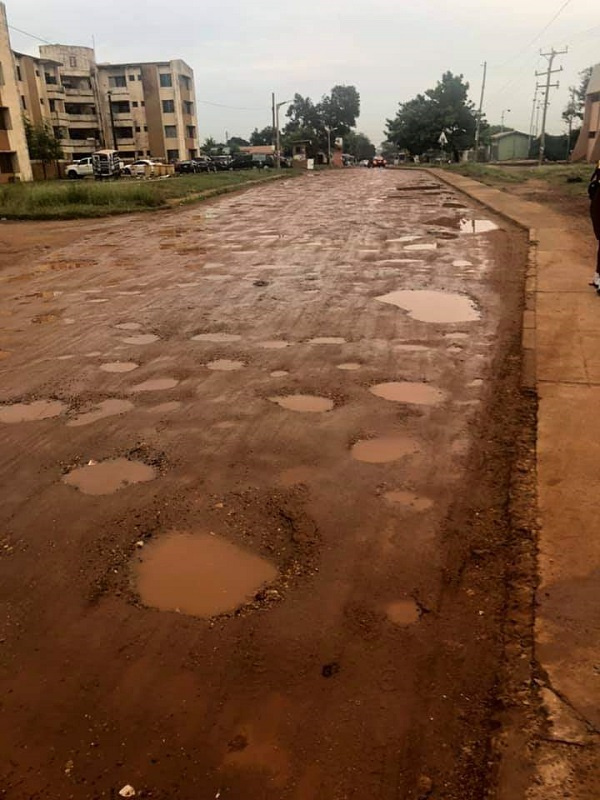 The holes in the road make it unmotorable and yet residents are 'forced' to use it