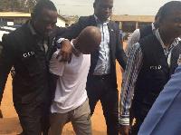 Daniel Asiedu (in white) is standing trial for murder