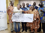 An official of Geodril (second left) presents the cheque to a TAMASCAN old student