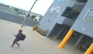 A photo of Natashia in the deceased's outfit walking out of the hotel premises