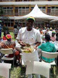Ken Ofori-Atta eating his waakye at the 'Kenkey Party'