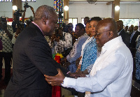 President John Mahama in a handshake with Nana Akufo-Addo