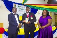 Dr Adu Boateng & Mrs Deborah Paintsil receiving the award
