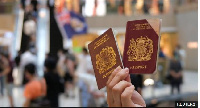 A Hong Kong protester raises British National Overseas passport