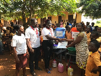 Members of the Rotaract Club of Aflao presenting the items to the schools
