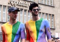 Two men at a gay pride parade