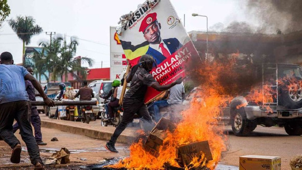 A supporter of Ugandan MP Bobi Wine protests against his arrest during his presidential rally (AFP)