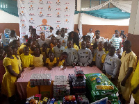 Jonathan Mensah in a group picture with students of Dzorwulu Special School