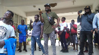 Samini performs for the students