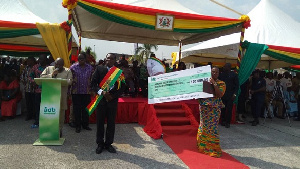 Philip Kweku Agyemang [left] was given a cheque for US$100,000 as the grand prize.