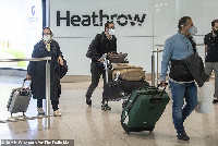 Travellers as dem dey arrive for UK airport