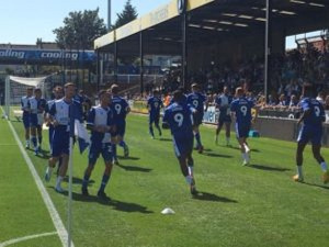 Bristol Rovers players warming up in Agogo favourite Number 9 shirts