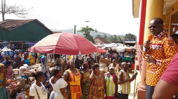 Dr Nduom addressing GN Bank customers and traders at Dzemeni Market