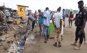 Some Ghanaians desilting choked gutter