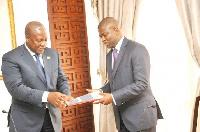 Mr Steve Williams presenting the report to President Mahama
