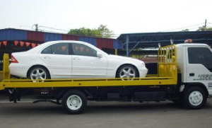 One of the cars being towed