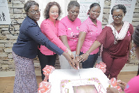 Cutting the Pink Power Cake to launch the event