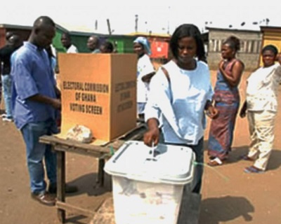 Woman casts her ballot.     File photo.