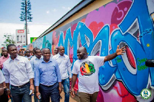 Mayor of Accra, Adjetey Sowah and some officials observing the designs