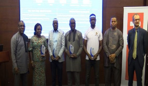 Award winners in a group photo with some dignitaries