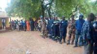 Some security officers queue at a voting centre