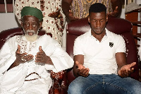 Dr.Osuman Nuhu Sharubutu praying with Patrick Allotey