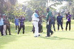 Otumfuo Osei Tutu II (right) congratulating Osagyefo Amoatia Ofori Opanin II after they teed-off