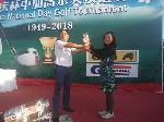 Mrs Yun Zheng (L) receiving her prize from Kwaku Li
