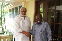 Former President Jerry John Rawlings in a handshake with President-elect Nana Akufo-Addo