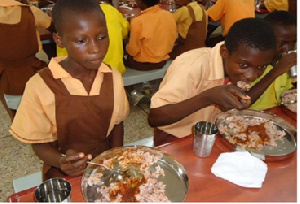 School pupils enjoying government free hot meal per day
