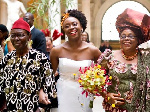 Chimamanda with her parents walking her down the aisle