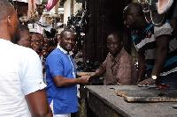 Mr. John Kumah CEO of NEIP visited the Kumasi Central Market