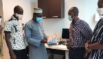 HOZDA President, Muhammed Awal Zakaria receiving the cash donation of  $3,500