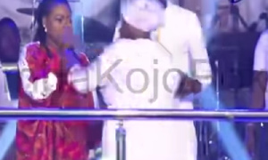 Cecilia Marfo [R] snatching the microphone from Joyce Blessing [L]