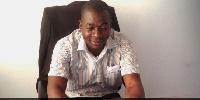 Mr Albert Adongo in his office