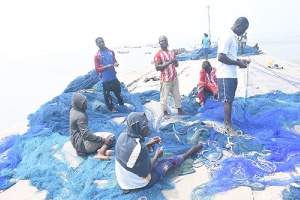 Some Of The Fishermen Mending Their Nets At James Town Photo Seth Osabukle