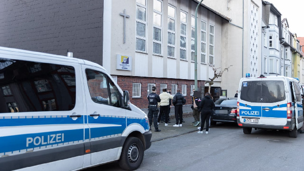 The police in Germany distracting the congregation from worshipping