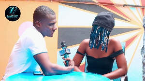 Blogger ZionFelix with self acclaimed lesbian, Adwoa covered in a mask