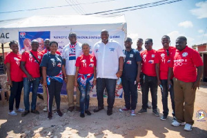 Some members of the Patriotic Professionals in a photo with some residents
