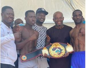 John Laryea with Asamoah Gyan, Sammy Anim and his opponent Sebastianus Natanael at the presser