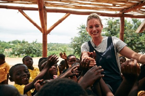 Former Pussycat Doll Kimberly playing with some kids in Ghana