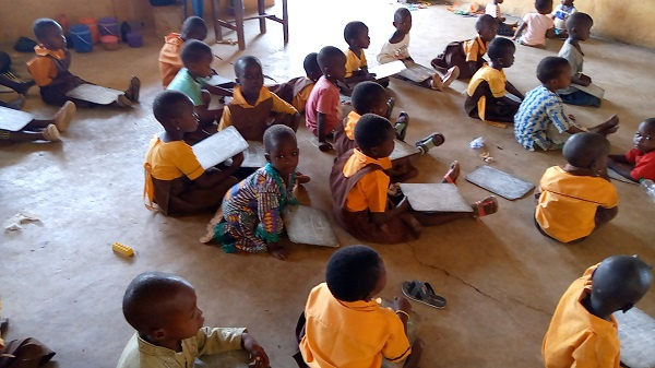Pupils lie on belly to study at GUMO D/A Primary School