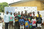 Lartey with some of the children who participated in the table tennis fair