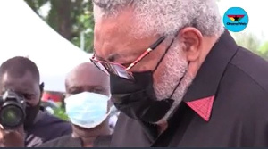 Former President Jerry John Rawlings in a solemn mood at his mother's funeral