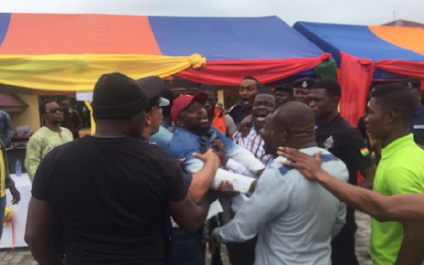 The NPP youth in a scuffle with the Upper West Akyem DCE